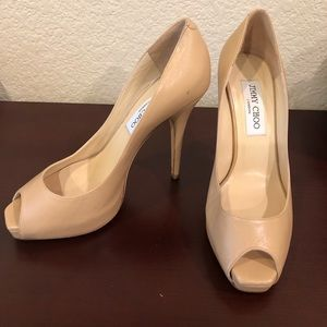 Beige peep toe Jimmy choo pumps.